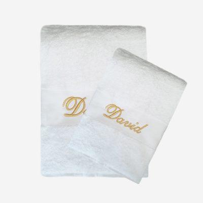 Vit handduk med namn och guldtext